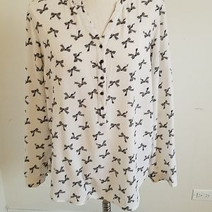 Cream blouse with black bows